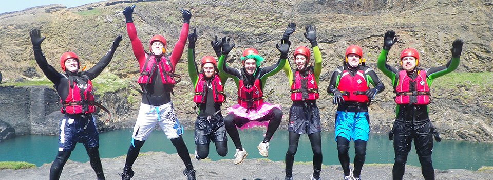 Stag party jumping at Blue Lagoon Abereiddy, Coasteering in Pembrokeshire Wales